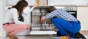 repairman doing dishwasher repair, installation, and maintenance