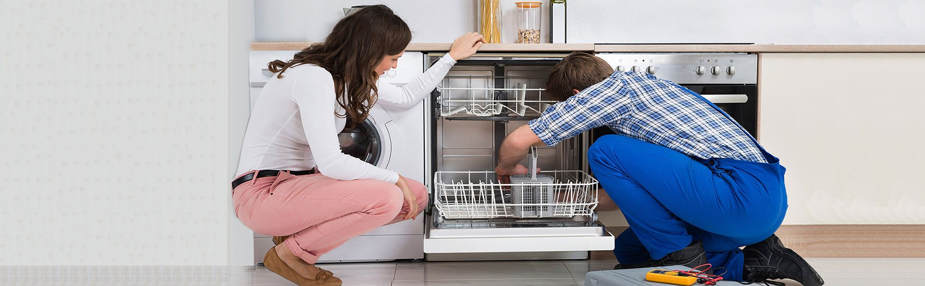 repairman fixing dishwasher. Dishwasher repair and maintenance