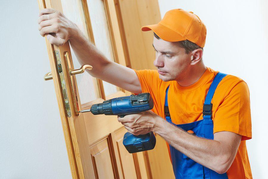 locksmith repairman fixing lock
