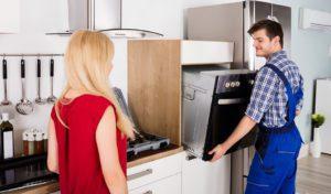 repairman installing oven appliance